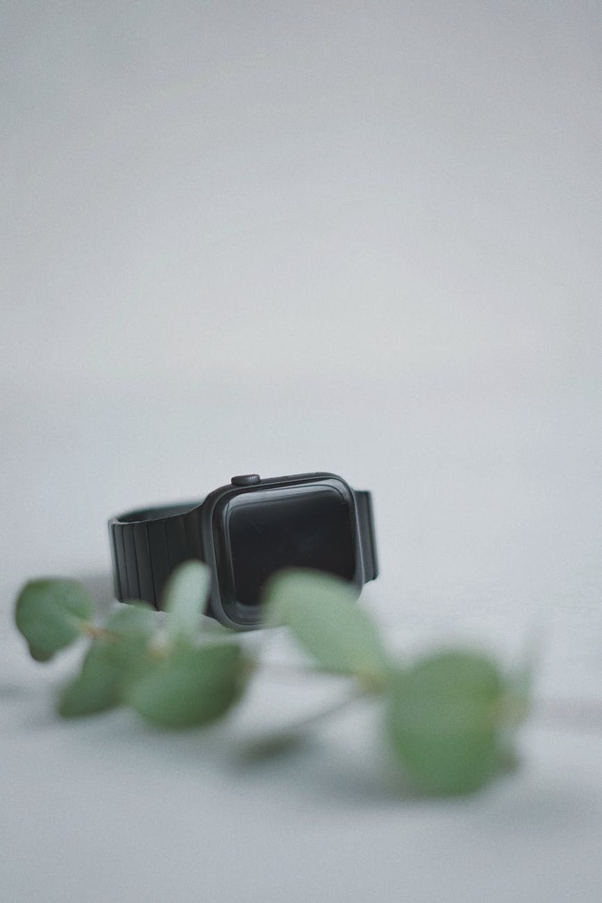 black smart watch on white surface