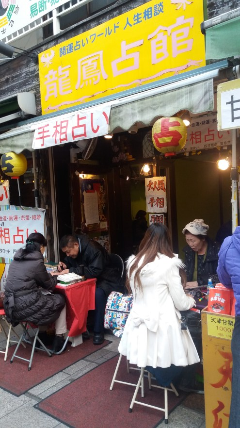 One of China Town's many palmistry cafes