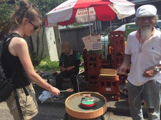 Being taught the ways of the spinning top by Japanese Dumbledore in Yanaka