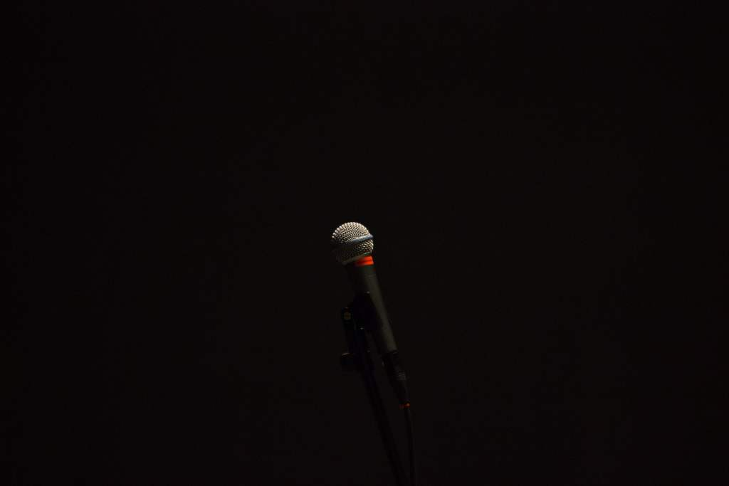 Microphone in black space.