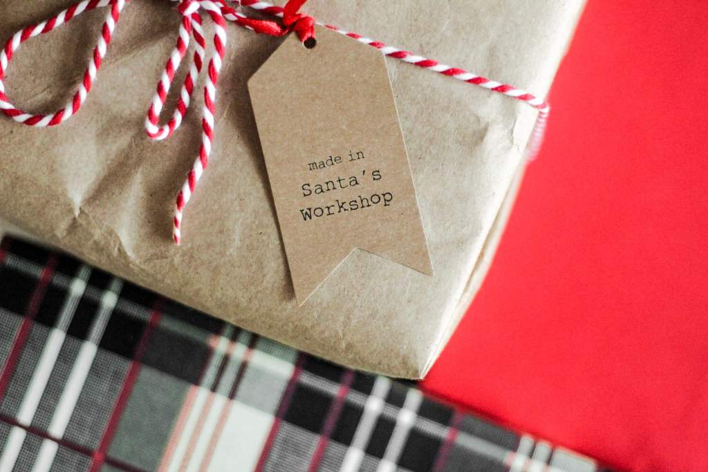 Present wrapped in brown paper with a gift tag.