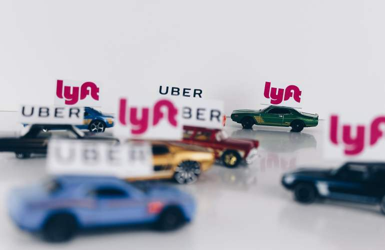 Uber and Lyft on mini toy cars.
