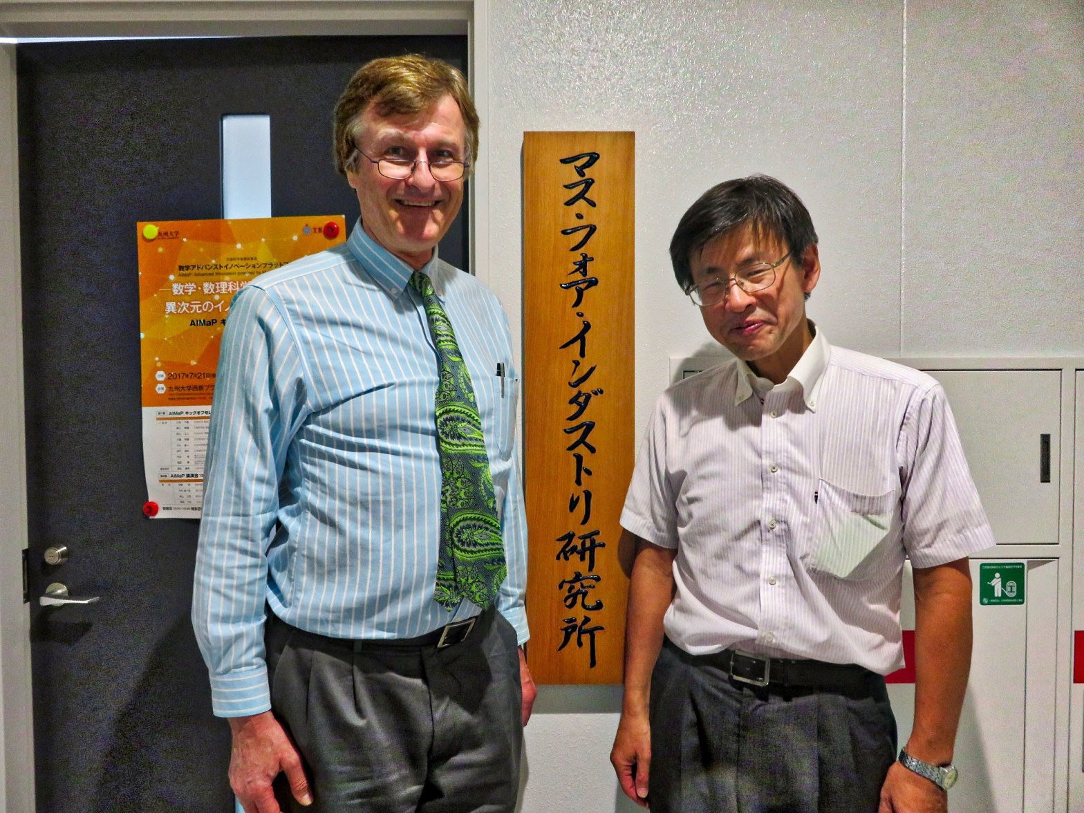 Mathematics for Industry Institute Director Yasuhide Fukumoto and Gerhard Fasol