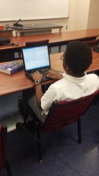 Waweru Kariu working on programming