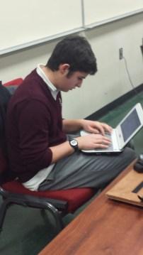 Andrew Medina working hard on the CAD