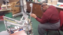 John Howard explaining the arms of the robot.