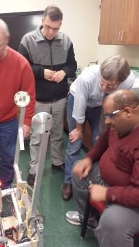 Mentors examining the arms.