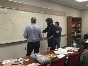 Mentors discussing the design of the robot