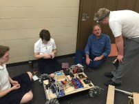 Members of the Build team working on last year's robot