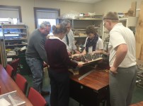 Members of Build working on the drive train