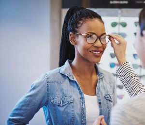 optometrist-helping-a-patient-find-their-perfect-frames