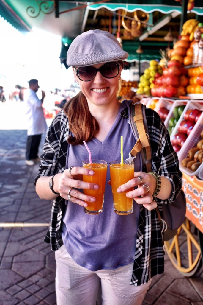 Looking happy because she has both of the juices