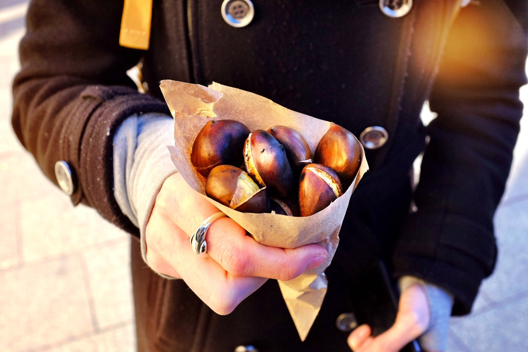 Sarah holding Chestnuts at the Christmas markets in Strasbourg