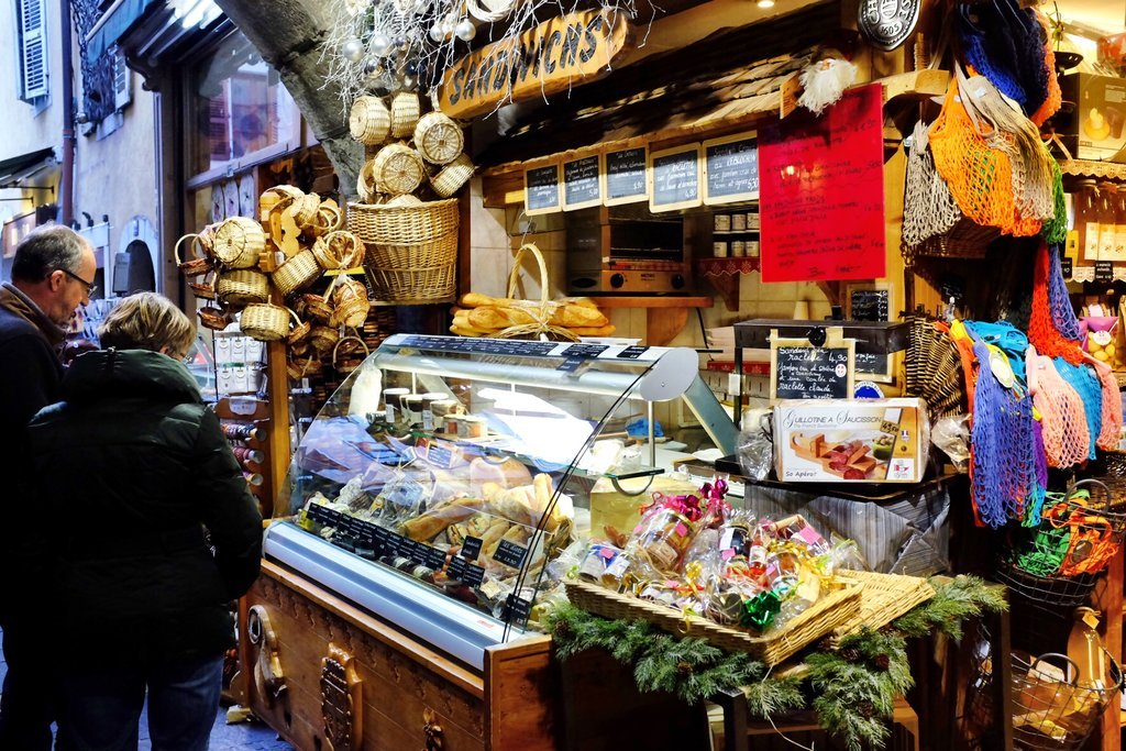 Little artisan shop in Annecy selling bread, cheese and other food products like for example salami or liquors
