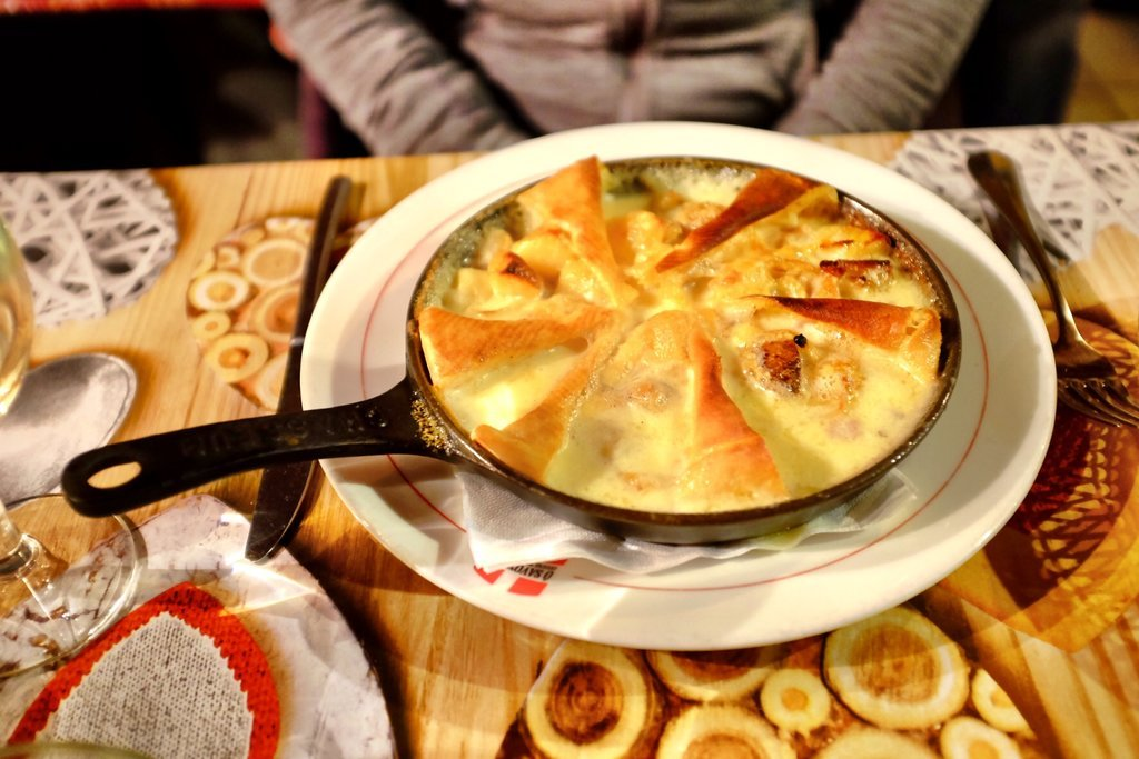 Tartiflette french cheese dish in pan
