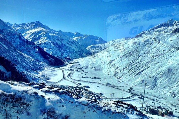 Andermatten surrounded by snowy Swiss alps as seen from the Glacier Express