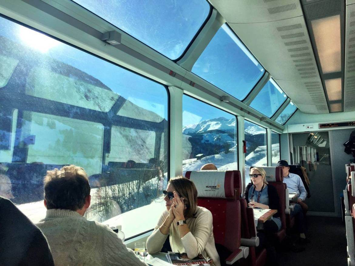 The intérieur of the Glacier Express with the Alps in the background