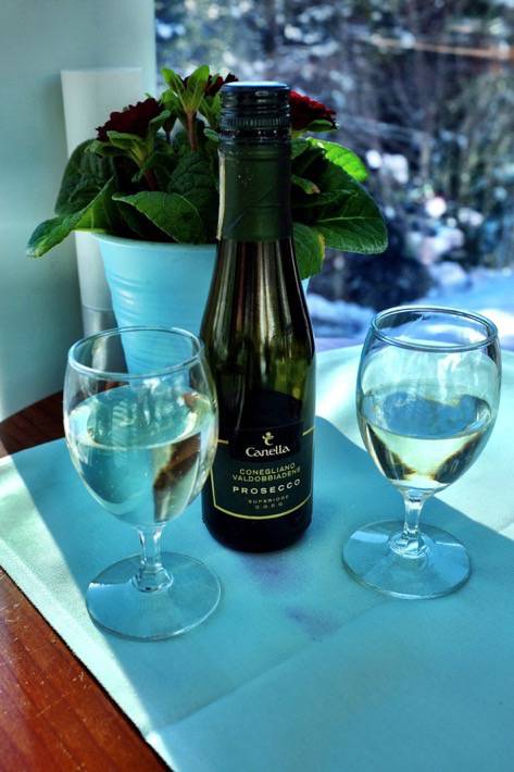 A bottle prosecco with two glasses we had on our trip with the Glacier Express