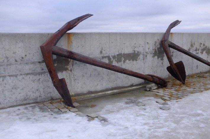 Two anchors at the Seaplane Harbour museum leaning at a wall