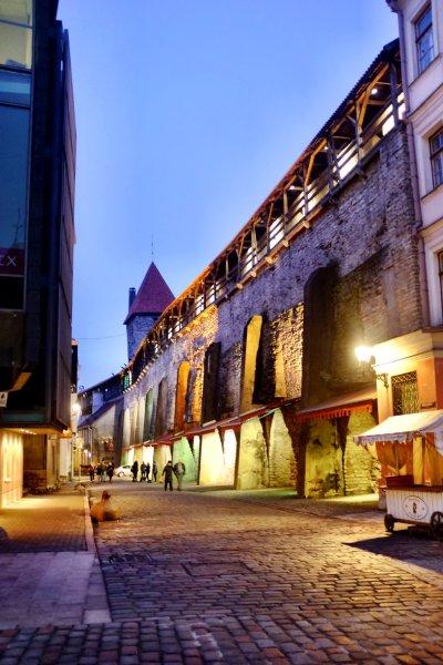 Tallinn city break Helleman Tower and city walls, lit up at dusk