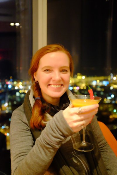 Tallinn city break Sarah drinking a mango chilli coriander Cocktail at the Horisont Bar in Tallinn