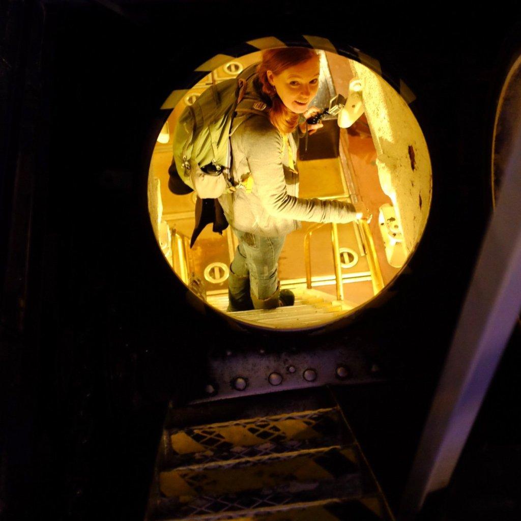Sarah entering the Submarine in the Seaplane Museum in Tallinn