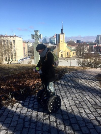 Tallinn city break Sarah's standing on a segway in Tallinn