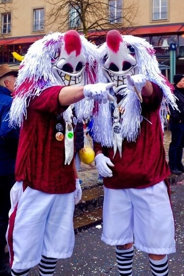Two Waggis posing for a photo during Basel Fasnacht