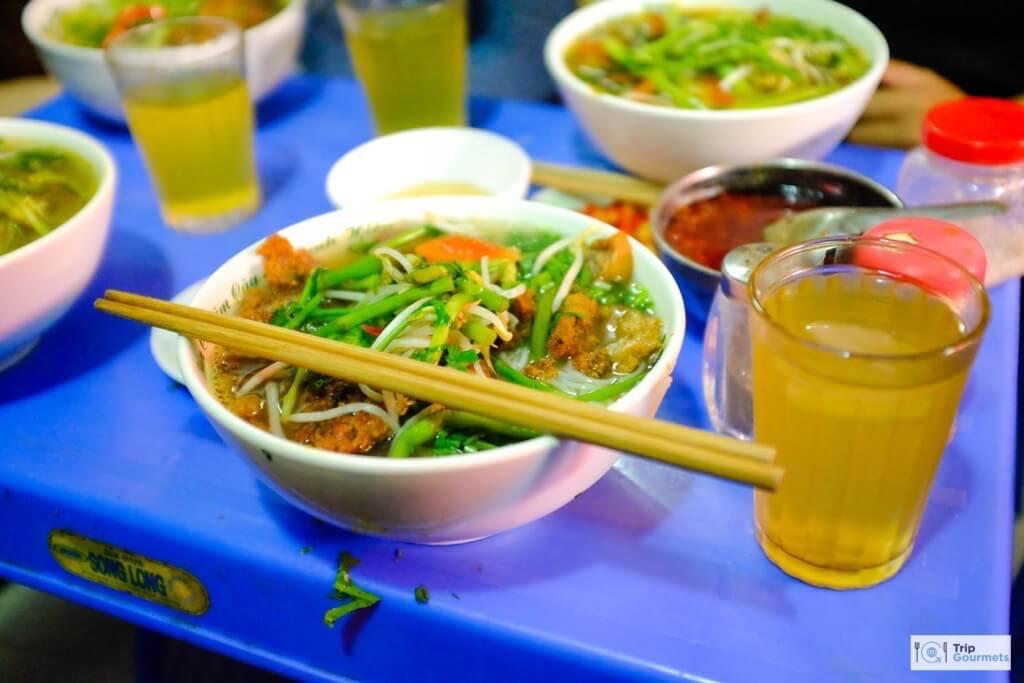Food in Hanoi Old Quarter bun ca green iced tea chopsticks