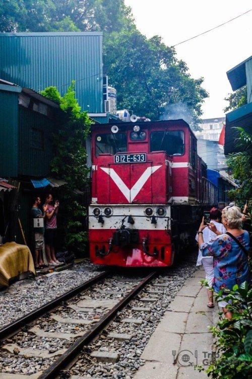 Hanoi train street red train approaching