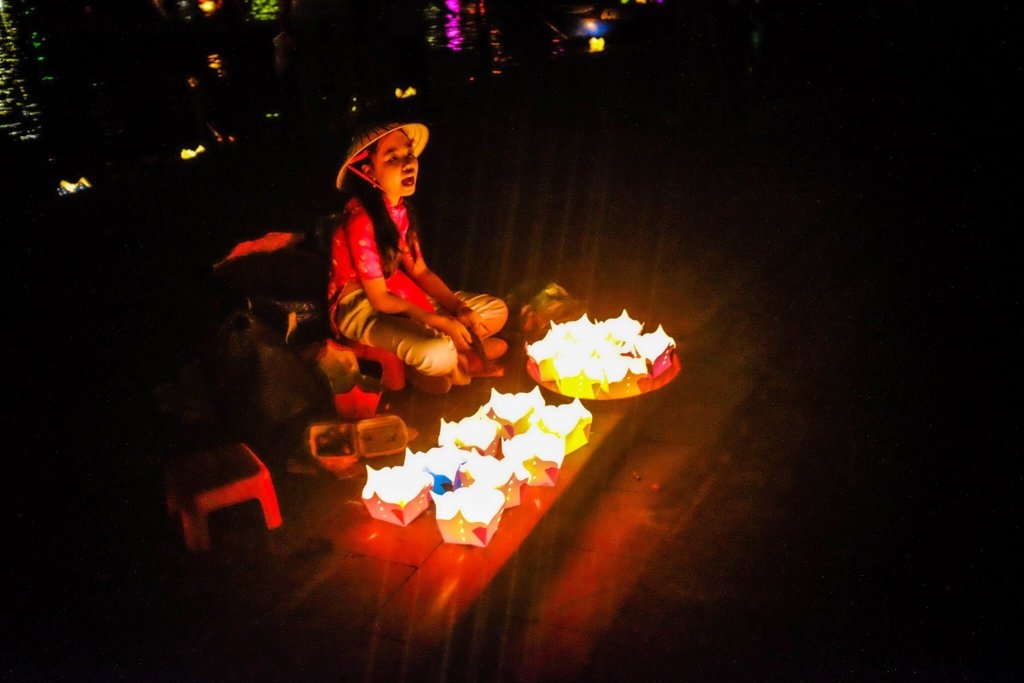 Hoi An Lantern Festival girl selling sitting