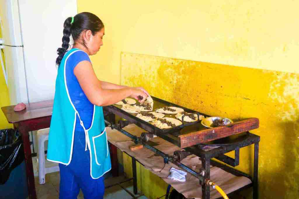playa del carmen cooking classes - Lady cooking Quesadillas
