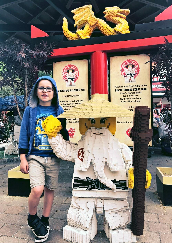 Posing outside the Ninjago ride at Legoland Windsor.