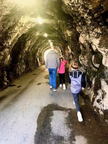 Family walking in a cave