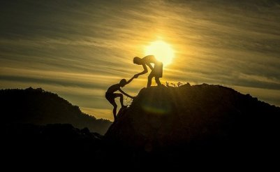 Friends climbing a mountain.