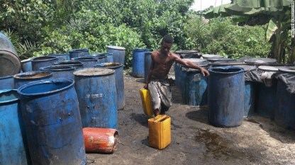 150615102133-nigeria-gin-carry-barrel-exlarge-169