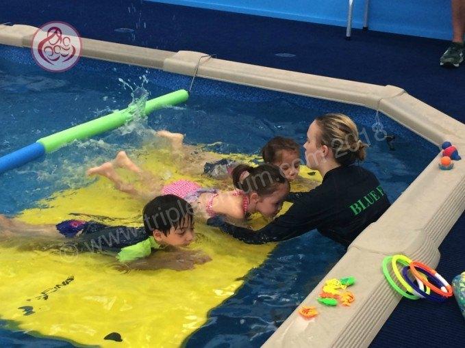 triplets swimming lesson