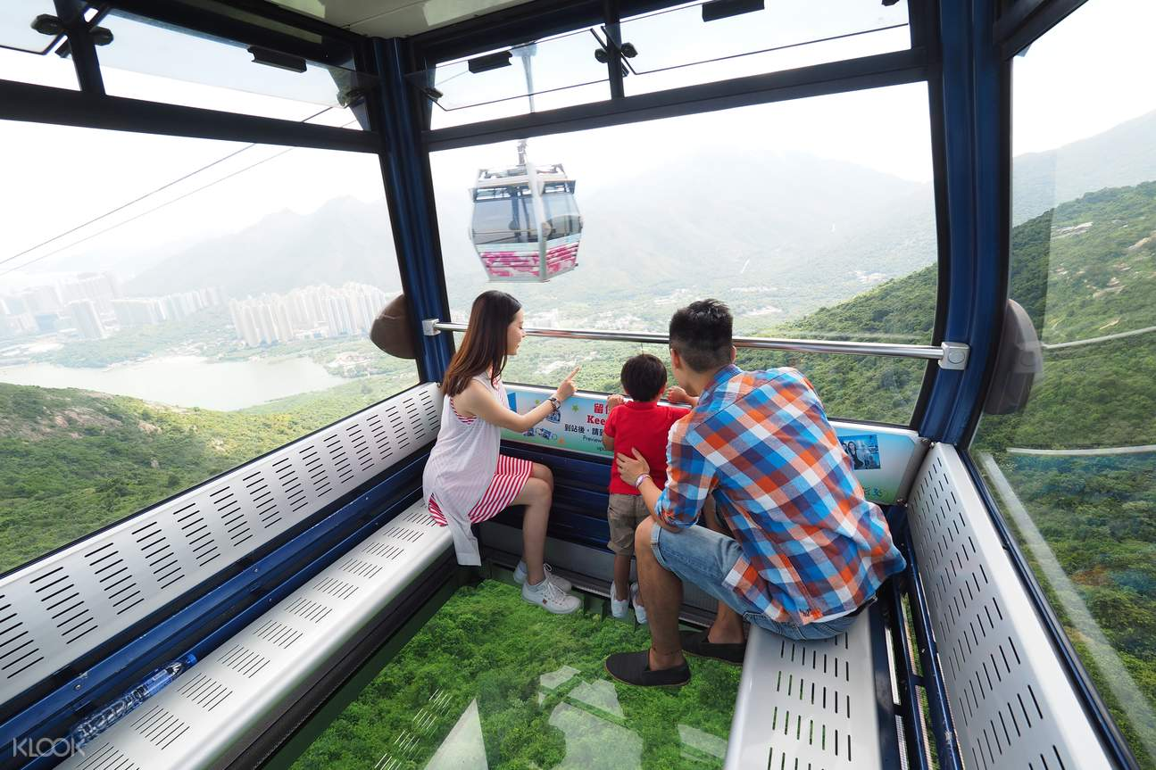 A family on Crystal Cabin coming to Ngong Ping