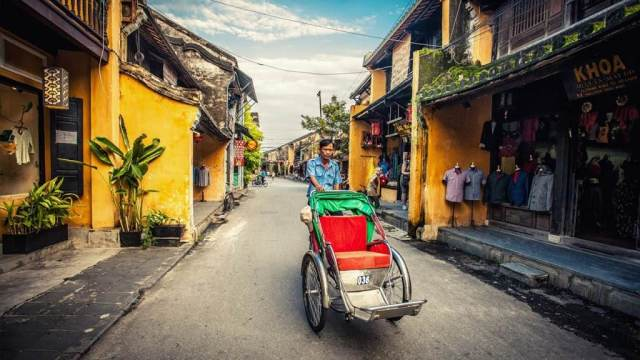 Cyclo around the old street Hoi An