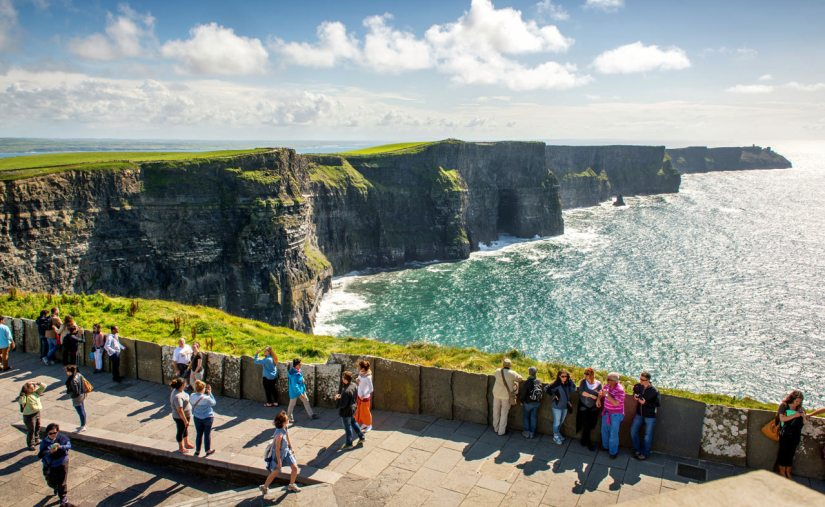 tourist walk along in Cliffs of Moher dublin