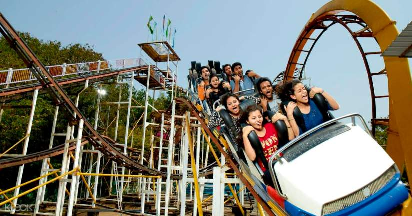 kids sit on the roller coaster at EsselWorld theme park