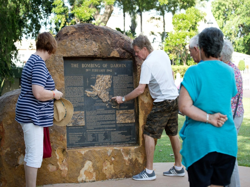 people stand in front of Bombing Of Darwin WWII