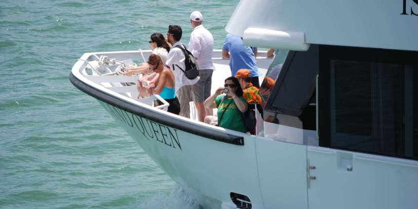 visitors are on the sundeck of Miami Biscayne Bay Boat Tour