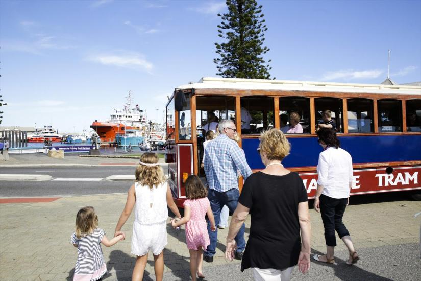 kids and their parent step on a Fremantle Prison tram
