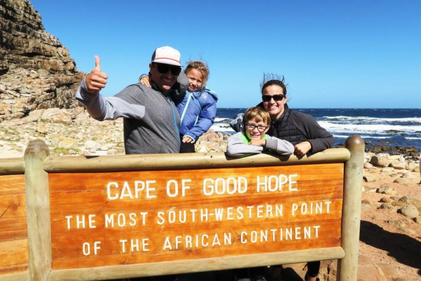 A family takes a photos at Cape of good hope