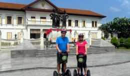 Jim Cheney and Julie Cheney from tripologist.com ride on segways with Segway Gibbon in Chiang Mai, Thailand.