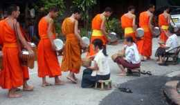 The monks of Luang Prabang complete their morning alm ritual.