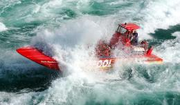 A Whirlpool Jet Boat splashes through class-5 rapids on the Niagara River.