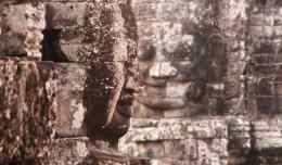 Two of the stone faces at Bayon Temple in Angkor Thom in Siem Reap, Cambodia.