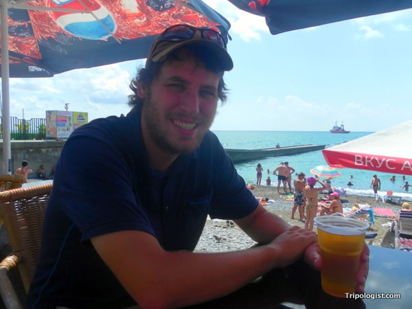 Me enjoying a beer along the banks of the Black Sea in Sochi.
